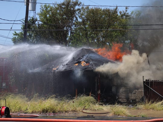 A building caught fire Thursday, May 17, 2018, near the intersection of South Port Avenue and Baldwin Boulevard. The Corpus Christi Police Department's bomb squad also responded after Corpus Christi firefighters who responded said they found a grenade at the scene.