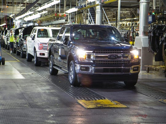 The first Ford F-150 truck built after an eight-day shutdown rolls off the line on May 18, 2018, at Dearborn Truck Plant. The assembly line restarted after a supplier fire.