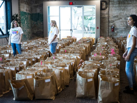 Volunteers work to hand out packets for Beach to Bay