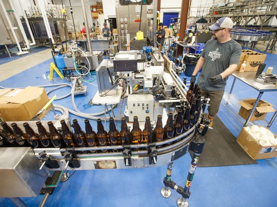 Bottling at Toppling Goliath's new location in Decorah Tuesday, May 8, 2018.