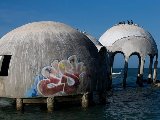Graffiti marks a good portion of the dome home off the coast of Cape Romano just south of Marco Island on May 9, 2018, in the Gulf of Mexico.