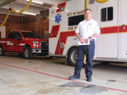 Marion City Fire Chief Chuck Deem stands beside the