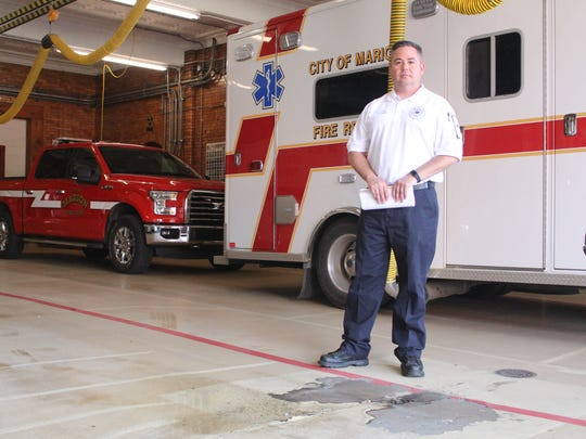 Marion City Fire Chief Chuck Deem stands beside the part of the bay floor at the main fire station that was cracking in 2017. The city is considering a new levy to finance needs at the fire department.