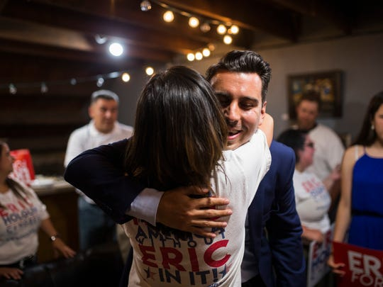 Eric Holguin, Democratic candidate in the District 27 congressional race, hugs a supporter after winning the Democratic nomination on Tuesday, May 22, 2018 at the Exchange.