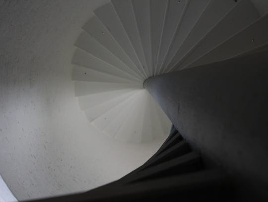 Looking up the spiral staircase to the top of the 82-foot