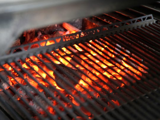 Coals should be white-hot on charcoal grills, with