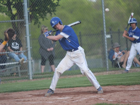 Oak Creek's Max Magyer ducks out of the way of a pitch