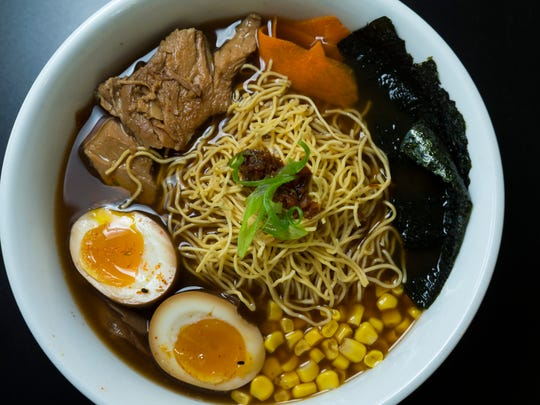 At the center of the pork ramen at Sushi Go are noodles with a springy texture.