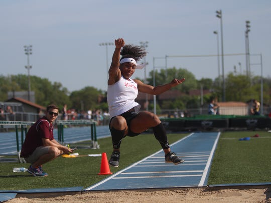 Armoni Brown of Waukesha South leaps en route to a first-place finish in the long jump at the West Allis sectional on May 24, 2018.