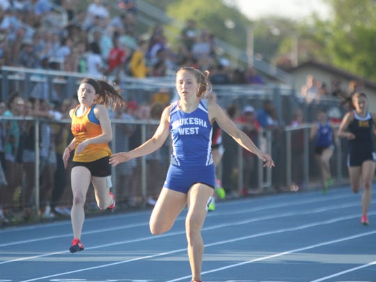 Waukesha West's Maddie Frey crosses the finish line in first place in the 400 meter dash at the West Allis sectional on May 24, 2018.
