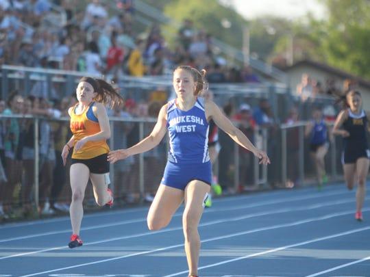 Waukesha West's Maddie Frey crosses the finish line