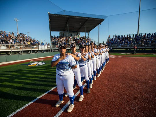 Santa Gertrudis Academy stand for the national anthem in the Class 3A regional softball final on Friday, May 25, 2018, at Cabaniss Field.