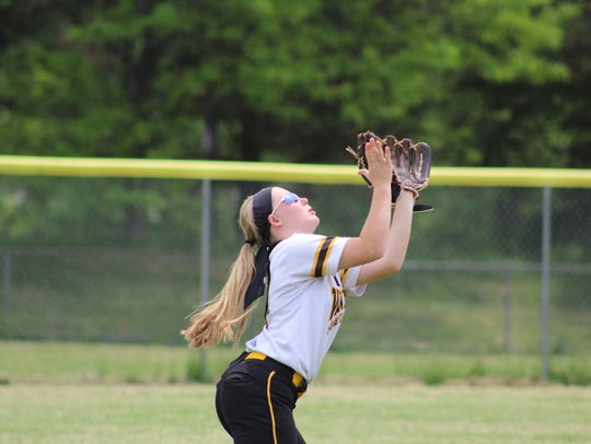 Windsor shortstop Allison Smith eases under a pop during