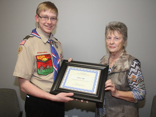 Mason Erger (left) is presented withthe Friends of