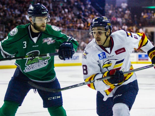 Florida Everblades' Matt Mackenzie looks to check Colorado's J.C. Beaudin during Game 2 of the Kelly Cup Finals on Sunday, May 27, 2018, in Loveland, Colorado.