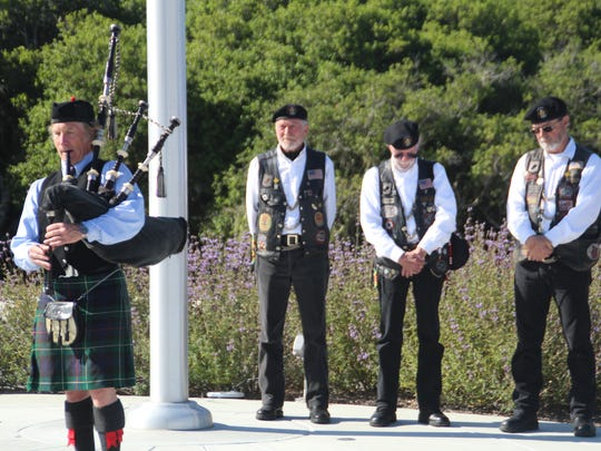 "Rick ""Phin"" Phinney and  Steve ""Pops"" Culver both of Salinas, and Hy ""Crash"" Libby, of Prunedale, listen somberly to a bagpipe at the first Meorial Day Ceremony at the California Central Coast Veterans Cemetery n."