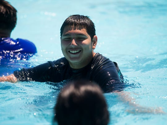 Dante Bautista, 15, laughs as he play in the water during the 3rd anniversary of Parker Pool party on Monday, May 28, 2018 in Flour Bluff.