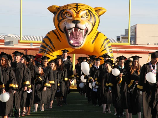 The Alamogordo High School graduating Class of 2018 enter Tiger Football Field to receive their diplomas Friday evening.