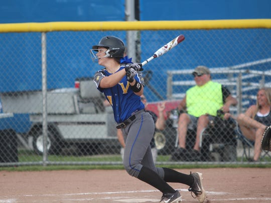New Berlin West's Kat Burkhardt watches her RBI single go through the infield in a sectional semifinal game against Whitnall on May 29, 2018.