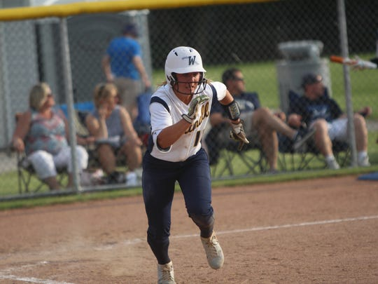 Whitnall's Haley Wynn sprints toward first base en route to a double during a sectional semifinal against New Berlin West on May 29, 2018.