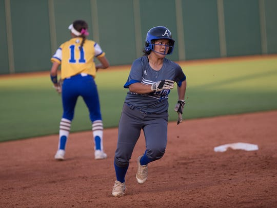 Santa Gertrudis Academy's Yadira Lopez rounds second base to to score during the sixth inning of the 3A state semifinal game against Brock at McCombs Field in Austin on Wednesday, May 30, 2018.