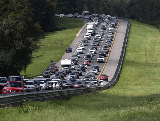 A long line of cars heads north from Florida on I-75,