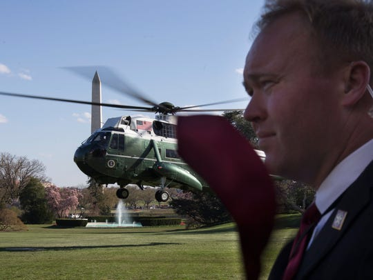A Secret Service agent on the White House lawn.