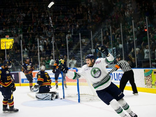 The Everblades celebrate after scoring the first goal during game 4 of the Kelly Cup Finals against the Colorado Eagles at Germain Arena on Friday, June 1, 2018.