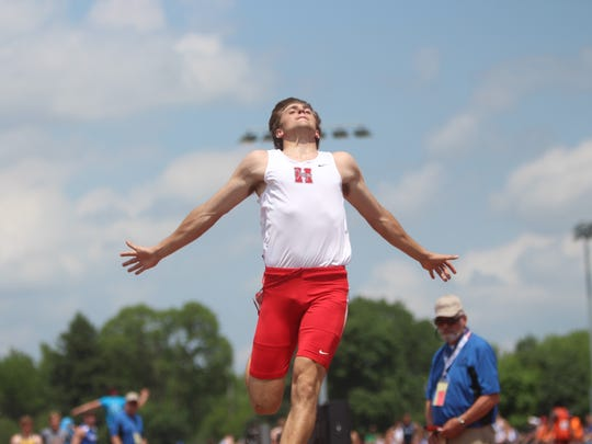 Sussex Hamilton's Ty Olejnik leaps to victory in Division 1 long jump competition.