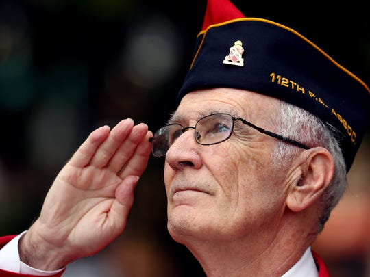 Ceremonial Officer James Cavanaugh salutes the flag during the playing of the National Anthem at the annual Morris Twp/Morristown Memorial Day ceremonies on the Morristown Green. May 28, 2018. Morristown, NJ