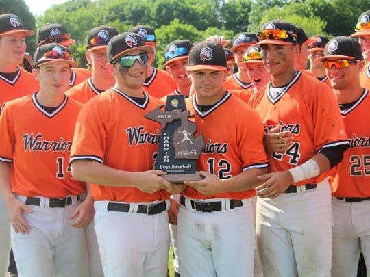 Brother Rice players celebrate the program's third district baseball championship in the past four years Saturday afternoon at Birmingham Groves.