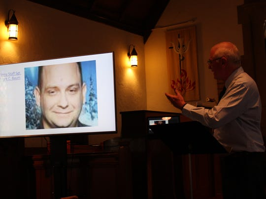 Chaplain Norris Burkes points to a photo of Staff Sgt. Mark C. Baum during a service at Trinity Lutheran Church in Crestline on Sunday, June 3, 2018. Baum, who was killed in action in Iraq, taught his fellow soldiers to be compassionate, Burkes said.