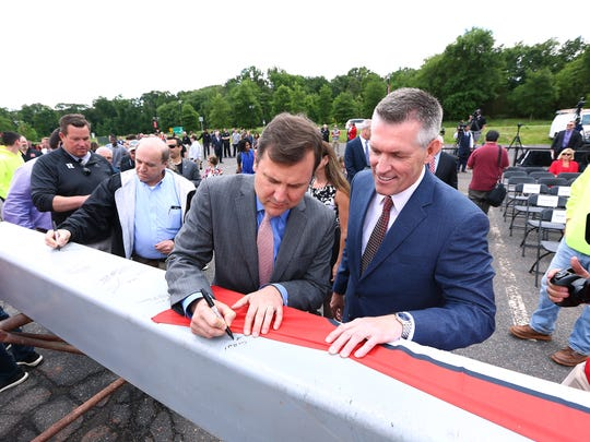Senator Tom Kean Jr., l, signs the final piece of structural steel as  Director of Athletics, Pat Hobbs looks on during the topping off ceremony at the 307,000 square foot  Rutgers RWJBarnabas Health Athletic Performance Center. June 3, 2018. Piscataway, NJ