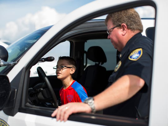 Rockport Police Patrol Cmdr. Larry Sinclair lets Aiden