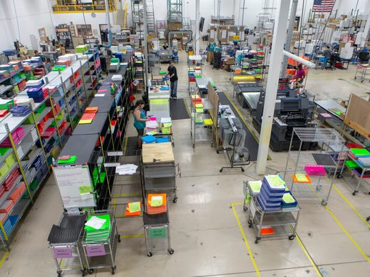 Workers at Artemax in New Berlin sort wristbands that will be shipped all around the world for music festivals, hospitals, water parks and more. Artemax president Bryan Waltersdorf estimates the plant manufactures 5 million to 6 million wristbands a day.