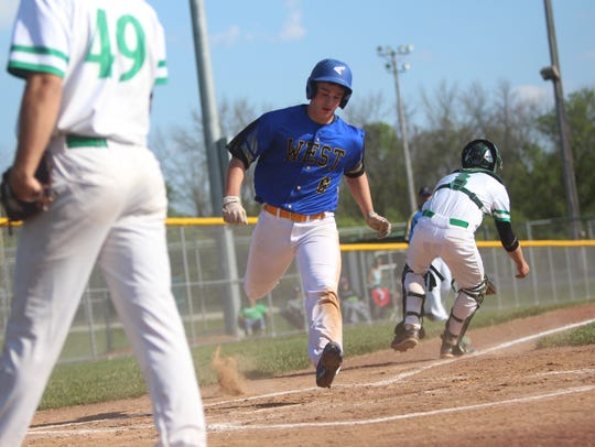 New Berlin West scores a run during a game against