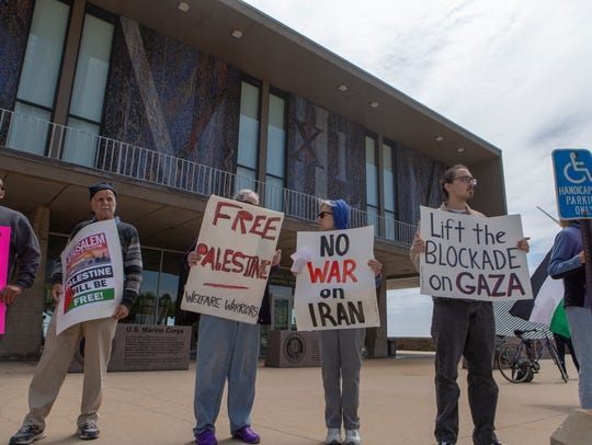 Demonstrators protest outside the Milwaukee County