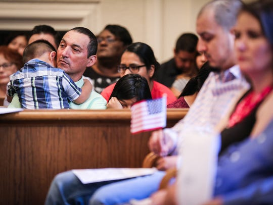 Family and friends listen to the speaker during the naturalization ceremony Wednesday, June 6, 2018, at the O.C. Fisher Federal Building.