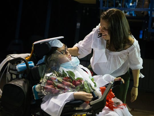 Nicole Albano, left, is congratulated by her mother Jennifer Albano after graduating from Glasgow High School after the school's commencement ceremony Wednesday, June 6, 2018 at the Bob Carpenter Center in Newark, Del.