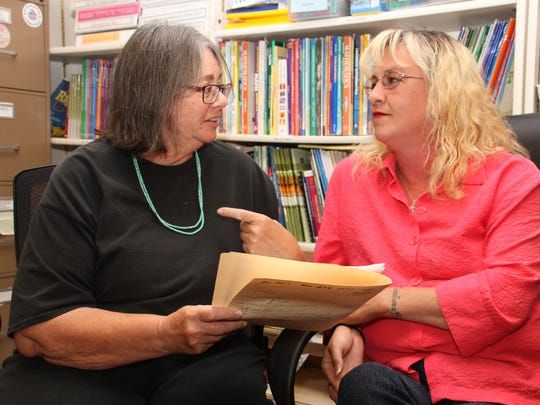 Mary Beth Folia, left, looks over HiSET (High School Equivalency Test) assessment records with student Jennifer Williams at the Silver City Public Library. Folia is the program director for Literacy Link-Leamos in Silver City and her office is in the library.