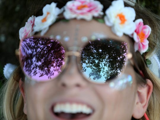 Rachel Boone, flower crown with sunglasses and at the