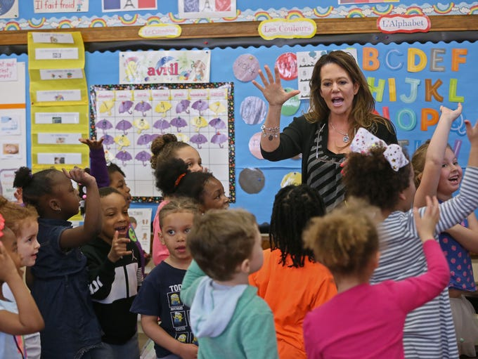 Teacher Dawn Balistreri works with K-4 students at