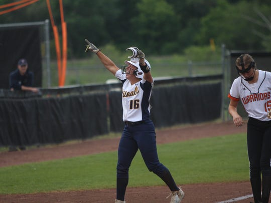 Whitnall junior Haley Wynn celebrates after getting to third base on a bunt in a state semifinal against Portage on Friday.