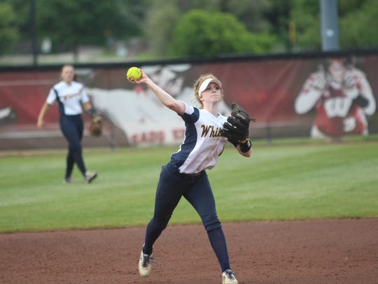 Whitnall shortstop Abby Cunningham throws to first