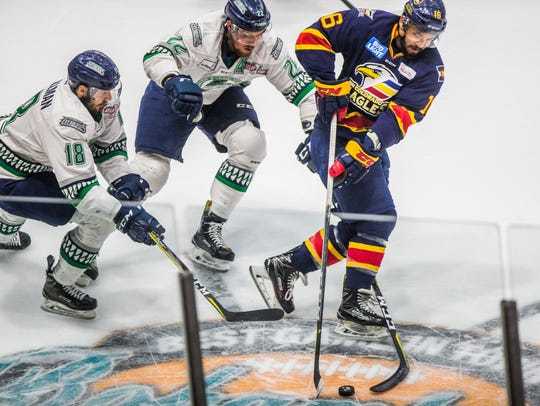 Colorado Eagles forward Michael Joly handles the puck against the Florida Everblades during Game 7 of the Kelly Cup finals at Germain Arena. The Blades lost 3-2.