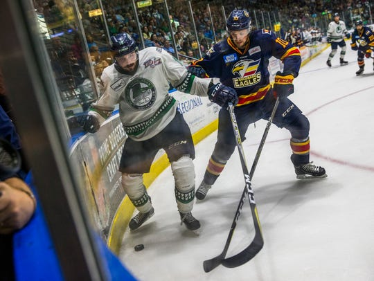 Florida Everblades player Spencer Smallman and Colorado Eagles player Collin Bowman compete for the puck during Game 7 of the Kelly Cup finals at Germain Arena. Smallman scored but the Blades lost 3-2.