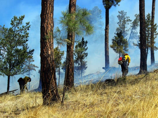 Ruidoso firefighters prevented the fire from running uphill in the grass.