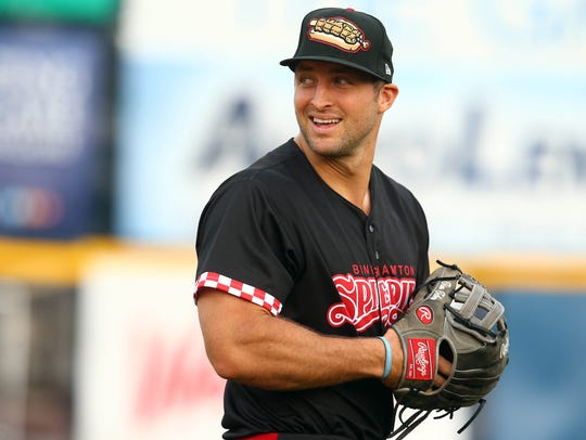 Binghamton Rumble Ponies left fi elder Tim Tebow smiles