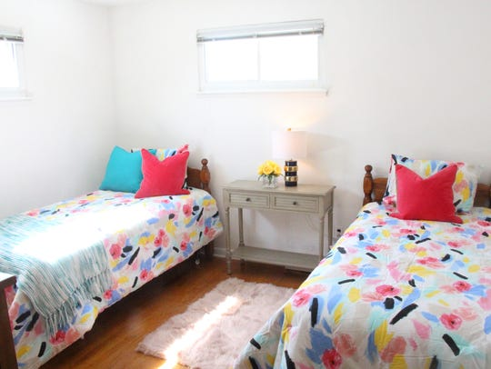 Second bedroom, after: New elements like bright, cheery