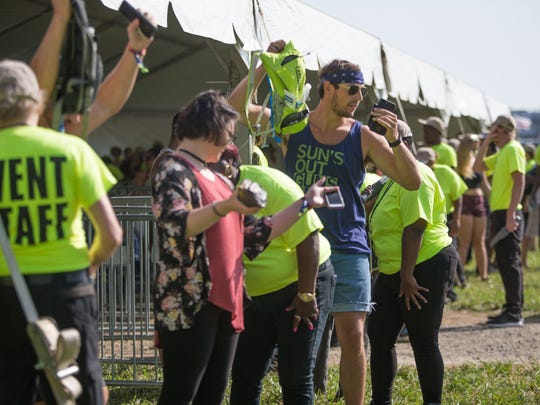 Fans go through a security check before entering the 2017 Firefly Music Festival in Dover.